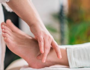 Applying-neuromuscular-massage-hitting-trigger-points-to-treat-chronic-pain-from-foot-tendonitis
